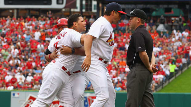 130603212929-yadier-molina-suspended-umpire-single-image-cut.jpg
