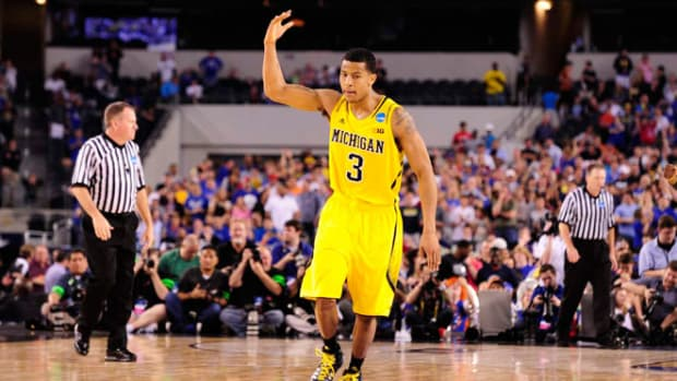 130330014931-trey-burke-three-michigan-win-overtime-kansas-single-image-cut.jpg