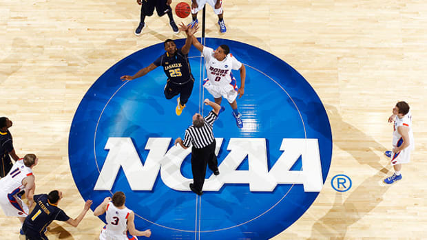 The NCAA is holding off on declaring sites for the First Four of the 2016 tournament and beyond. (Joe Robbins/Getty Images)