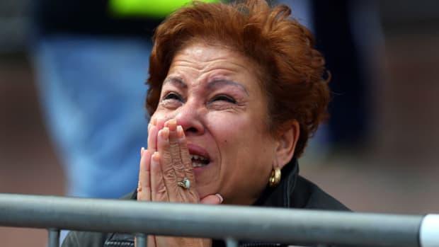 130415214019-woman-praying-boston-marathon-explosions-single-image-cut.jpg