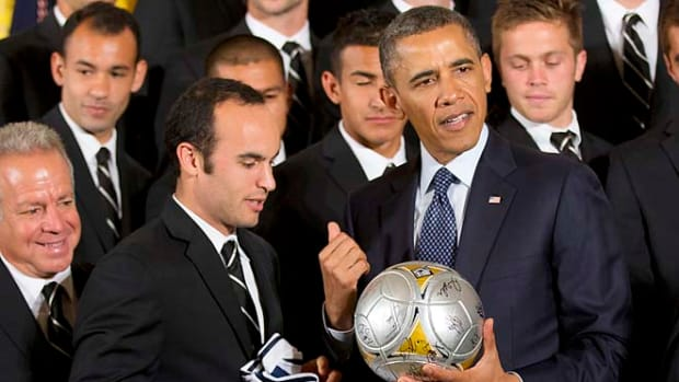 130328132828-landon-donovan-barack-obama-single-image-cut.jpg