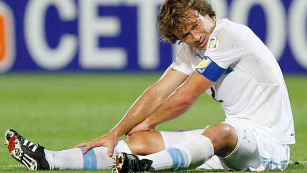 130123090100-diego-lugano-psg-malaga-single-image-cut.jpg