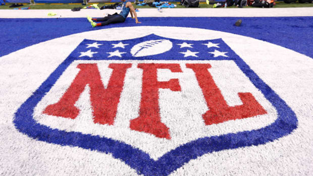 The NFL has protected its shield -- and its path to prime time -- in a historic settlement.