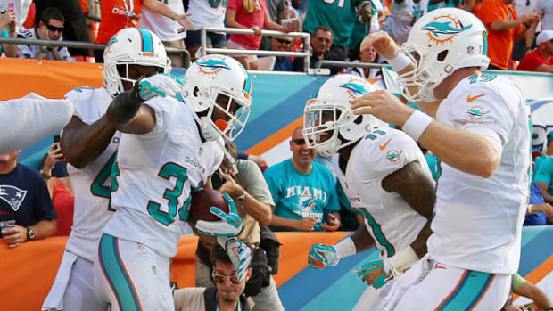 131215203102-miami-dolphins-new-england-patriots-week-15-snaps-single-image-cut.jpg