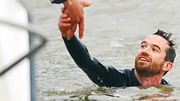120407060356-rowing-protester-story-getty-story-body.jpg