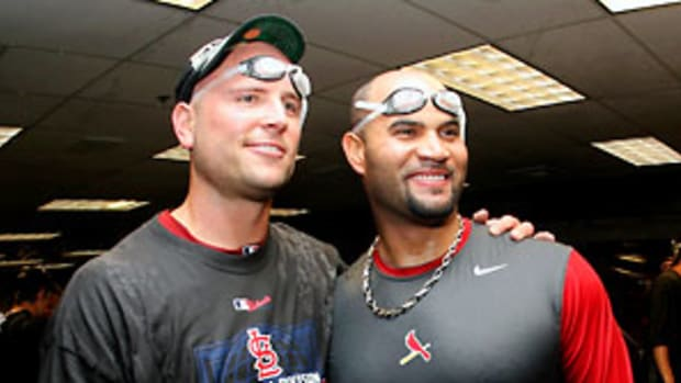 holliday-pujols-lemire.jpg