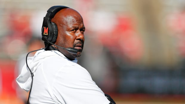 Maryland Terrapins head coach Mike Locksley coaches during the second half against the Rutgers Scarlet Knights at SHi Stadium.