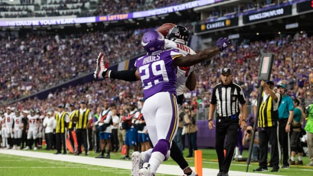 Minnesota Vikings cornerback Xavier Rhodes (29) breaks up a two point conversion intended for Atlanta Falcons wide receiver Justin Hardy (14) during the fourth quarter at U.S. Bank Stadium.