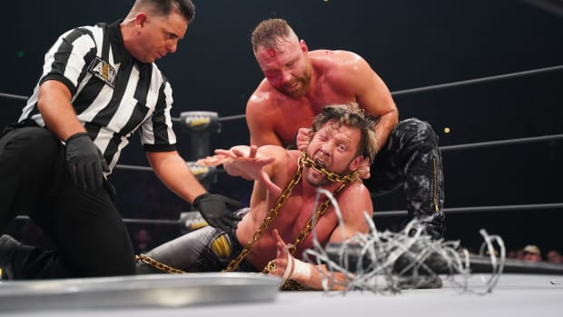 Kenny Omega and Jon Moxley in an unsanctioned match at AEW's Full Gear pay-per-view.