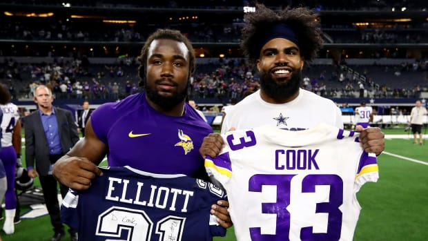 Nov 10, 2019; Arlington, TX, USA; Dallas Cowboys running back Ezekiel Elliott (21) poses for a photo after exchanging jerseys with Minnesota Vikings running back Dalvin Cook (33) at AT&T Stadium. Mandatory Credit: Matthew Emmons-USA TODAY Sports