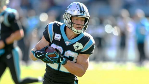 Nov 3, 2019; Charlotte, NC, USA; Carolina Panthers running back Christian McCaffrey (22) carries the ball for a touchdown in the second quarter against the Tennessee Titans at Bank of America Stadium. Mandatory Credit: Jeremy Brevard-USA TODAY Sports