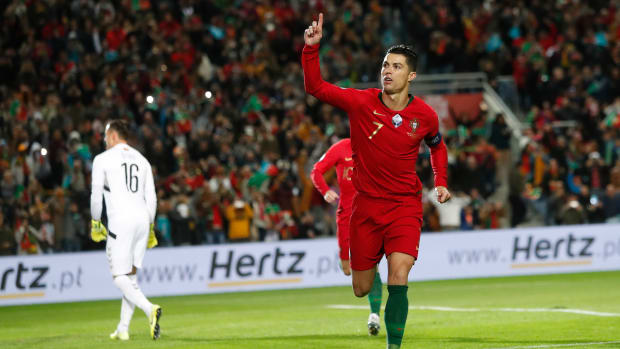 Cristiano Ronaldo scored a hat trick as Portugal routed Lithuania 6-0.