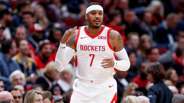 Nov 3, 2018; Chicago, IL, USA; Houston Rockets forward Carmelo Anthony (7) reacts after scoring a three pointer against the Chicago Bulls during the first half at United Center. Mandatory Credit: Kamil Krzaczynski-USA TODAY Sports