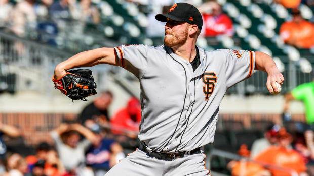 Sep 22, 2019; Atlanta, GA, USA; San Francisco Giants relief pitcher Will Smith (13) pitches against the Atlanta Braves during the ninth inning at SunTrust Park. Mandatory Credit: Dale Zanine-USA TODAY Sports