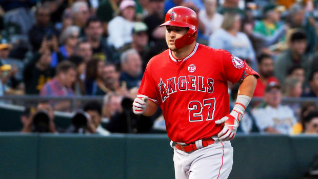 Sep 3, 2019; Oakland, CA, USA; Los Angeles Angels center fielder Mike Trout (27) rounds the bases on a solo home run against the Oakland Athletics during the first inning at Oakland Coliseum. Mandatory Credit: Kelley L Cox-USA TODAY Sports