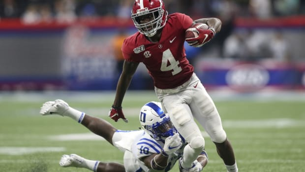 Alabama Crimson Tide wide receiver Jerry Jeudy (4) runs past Duke Blue Devils safety Marquis Waters (10) in the third quarter at Mercedes-Benz Stadium.