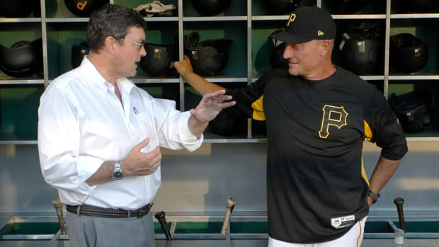 Sep 17, 2019; Pittsburgh, PA, USA;  Pittsburgh Pirates owner Robert Nutting (left) speaks with special assistant Jeff Banister (right) in the dugout before the game against the Seattle Mariners at PNC Park. Mandatory Credit: Charles LeClaire-USA TODAY Sports