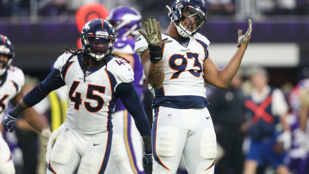 Denver Broncos defensive end Dre'Mont Jones (93) celebrates after sacking Kirk Cousins (not pictured) during the third quarter at U.S. Bank Stadium.