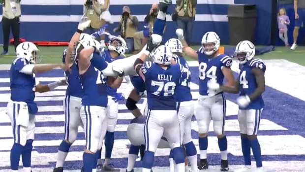 Colts lineman Quenton Nelson does a kegstand touchdown celebration.
