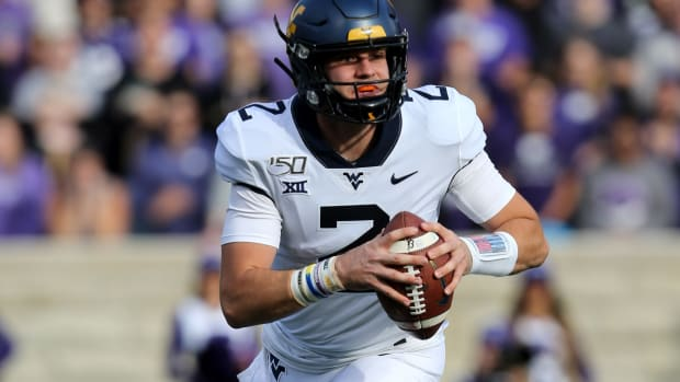 West Virginia Mountaineers quarterback Jarret Doege (2) drops back to pass during the first quarter of a game against the Kansas State Wildcats at Bill Snyder Family Stadium.