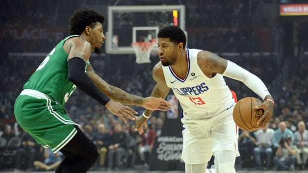 November 20, 2019; Los Angeles, CA, USA; Los Angeles Clippers forward Paul George (13) moves the ball against Boston Celtics guard Marcus Smart (36) during the first half at Staples Center. Mandatory Credit: Gary A. Vasquez-USA TODAY Sports