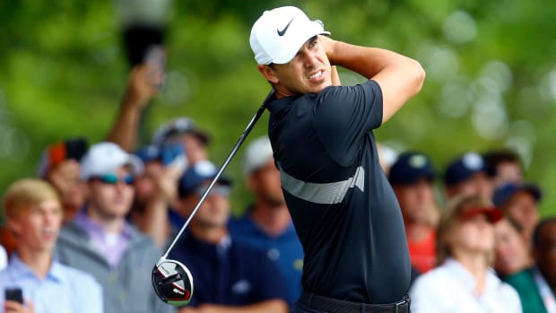 Aug 25, 2019; Atlanta, GA, USA; Brooks Koepka plays his shot from the tenth tee during the final round of the Tour Championship golf tournament at East Lake Golf Club. Mandatory Credit: Butch Dill-USA TODAY Sports