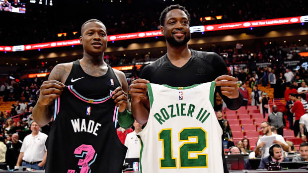 Jan 10, 2019; Miami, FL, USA; Boston Celtics guard Terry Rozier (L) and Miami Heat guard Dwyane Wade (R) trade jerseys after the Miami Heat defeat the Boston Celtics at American Airlines Arena. Mandatory Credit: Jasen Vinlove-USA TODAY Sports