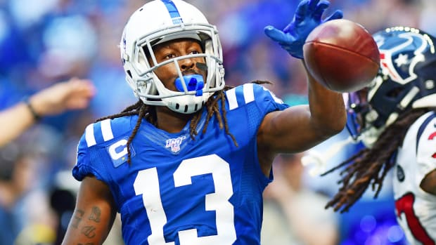 Indianapolis Colts wide receiver T.Y. Hilton, shown after gaining a first down in a home game last month, has missed the past three games with a calf strain but hopes to be able to play Thursday night t Houston.