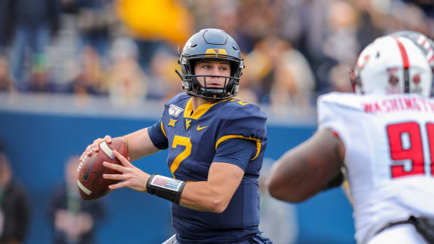 West Virginia Mountaineers quarterback Jarret Doege (2) throws a pass during the third quarter against the Texas Tech Red Raiders at Mountaineer Field at Milan Puskar Stadium.
