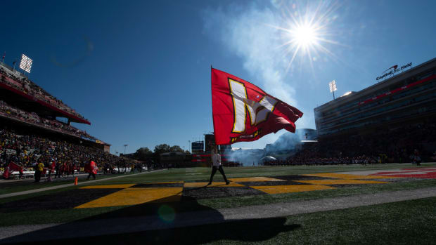 Maryland Terrapins spirit team waves a flag prior to the game against the Michigan Wolverines at Capital One Field at Maryland Stadium.