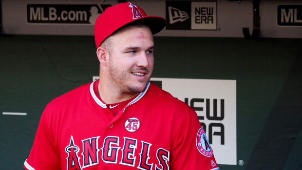 Sep 3, 2019; Oakland, CA, USA; Los Angeles Angels center fielder Mike Trout (27) reacts in the dugout before a game against the Oakland Athletics at Oakland Coliseum. Mandatory Credit: Kelley L Cox-USA TODAY Sports