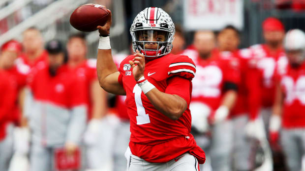 Nov 23, 2019; Columbus, OH, USA; Ohio State Buckeyes quarterback Justin Fields (1) drops to throw during the second quarter against the Penn State Nittany Lions at Ohio Stadium. Mandatory Credit: Joe Maiorana-USA TODAY Sports