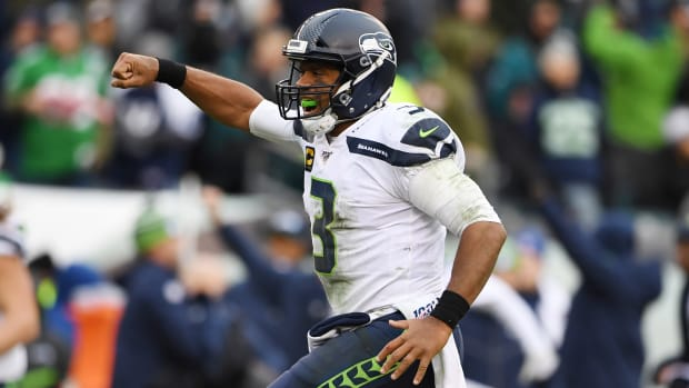 Seattle Seahawks quarterback Russell Wilson (3) reacts after a 58 yard touchdown run in the fourth quarter at Lincoln Financial Field.