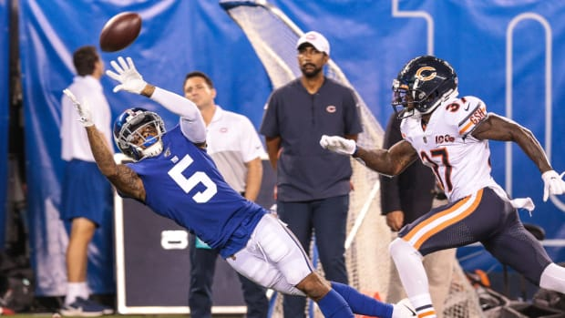 Aug 16, 2019; East Rutherford, NJ, USA; New York Giants wide receiver Da'Mari Scott (5) catches a pass as Chicago Bears defensive back John Franklin (37) defends during the second half at MetLife Stadium.