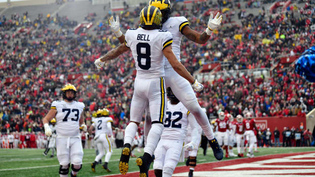 Michigan Wolverines wide receiver Ronnie Bell (8) celebrates a touchdown with his teammates during the first quarter of the game against the Indiana Hoosiers at Memorial Stadium