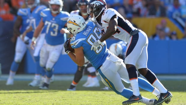 Los Angeles Chargers tight end Hunter Henry (86) catches a pass ahead of Denver Broncos defensive back Will Parks (34) during the second half at StubHub Center.