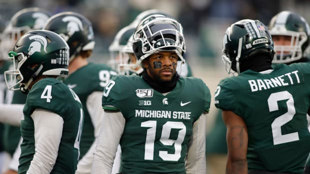 Michigan State's Josh Butler entered his Senior Day accompanied by his dogs after both his parents passed away.