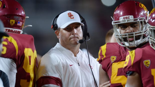 Clay Helton reacts against the Arizona Wildcats during the second half at the Los Angeles Memorial Coliseum