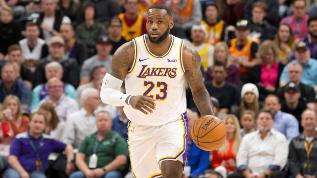 Lakers' LeBron James dribbles the ball upcourt vs. Jazz