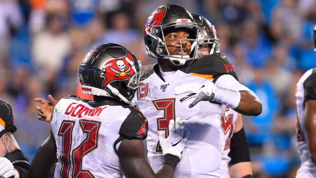 Sep 12, 2019; Charlotte, NC, USA; Tampa Bay Buccaneers wide receiver Chris Godwin (12) celebrates with quarterback Jameis Winston (3) after catching a touchdown pass In the second quarter at Bank of America Stadium. Mandatory Credit: Bob Donnan-USA TODAY Sports