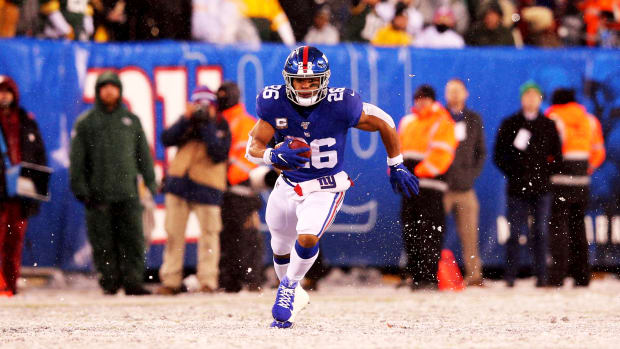 Dec 1, 2019; East Rutherford, NJ, USA; New York Giants running back Saquon Barkley (26) runs the ball against the Green Bay Packers during the fourth quarter at MetLife Stadium. Mandatory Credit: Brad Penner-USA TODAY Sports