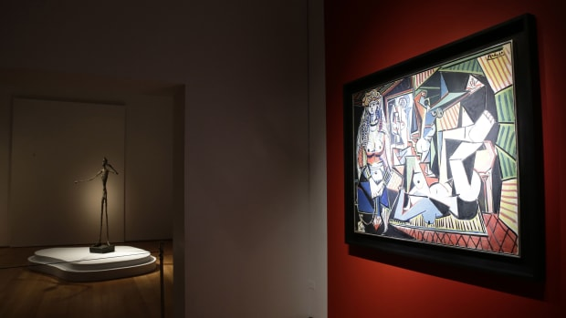 Pablo Picasso's painting 'Les Femmes D'alger and Alberto Giacometti's L'homme Au Doigt sculpture on display at auction at Christie's in New York