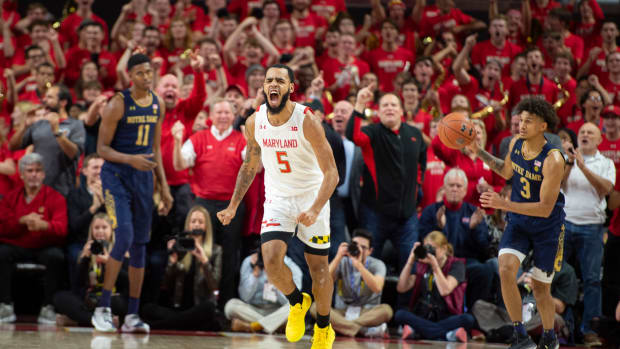 Maryland Terrapins guard Eric Ayala (5) reacts after scoring during the first half against the Notre Dame Fighting Irish at XFINITY Center.