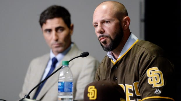 Oct 31, 2019; San Diego, CA, USA; San Diego Padres manager Jayce Tingler (right) is introduced as general manager A.J. Preller looks on at Petco Park. Mandatory Credit: Orlando Ramirez-USA TODAY Sports