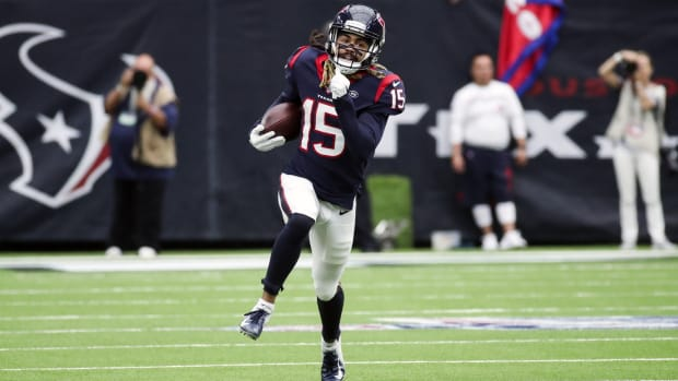 Houston Texans wide receiver Will Fuller (15) runs with the ball during the first half against the Atlanta Falcons at NRG Stadium.