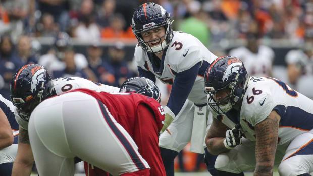 Denver Broncos quarterback Drew Lock (3) at the line of scrimmage during the first quarter against the Houston Texans at NRG Stadium.