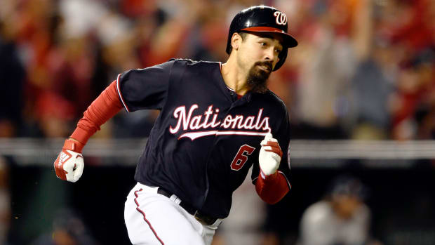Oct 25, 2019; Washington, DC, USA; Washington Nationals third baseman Anthony Rendon (6) runs to first base on a double during the first inning against the Houston Astros in game three of the 2019 World Series at Nationals Park. Mandatory Credit: Tommy Gilligan-USA TODAY Sports