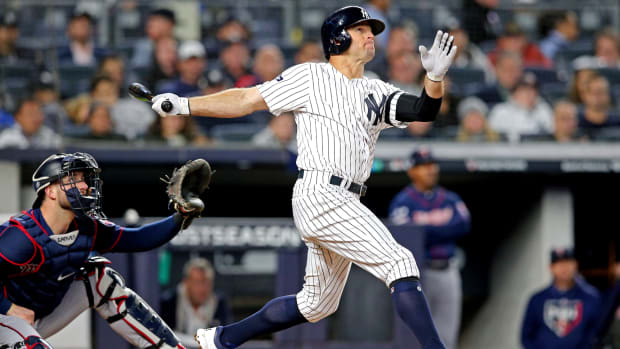 Brett Gardner homers during the American League Division Series against the Minnesota Twins.