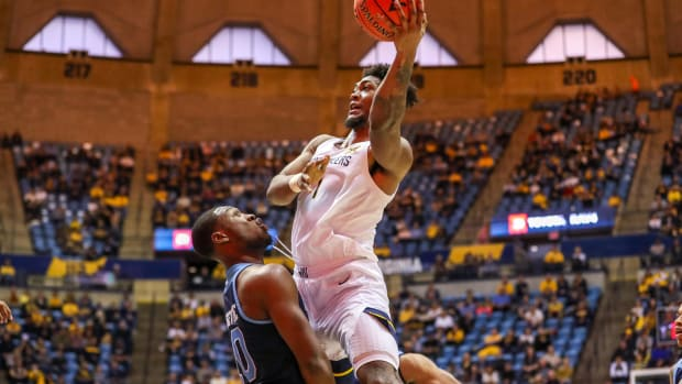 West Virginia Mountaineers forward Derek Culver (1) shoots during the second half against the Rhode Island Rams at WVU Coliseum.