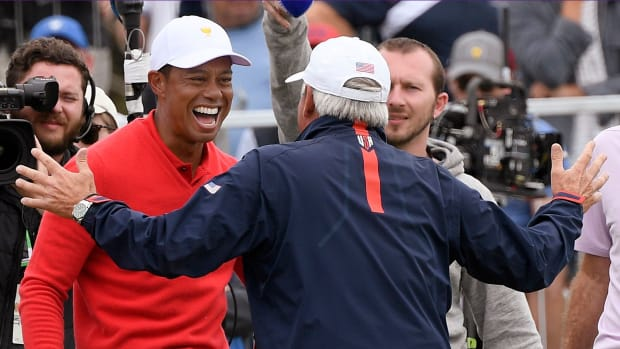 Team USA and Tiger Woods rallied to win their eighth straight Presidents Cup.